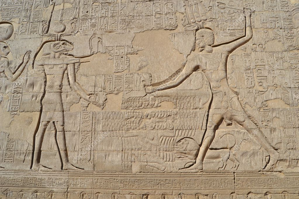 Hieroglyphic carvings on an egyptian temple wall — stock