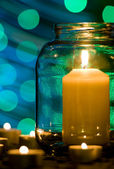 Candle in a glass jar — Stock Photo