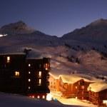 Dusk over a snowy alpine village — Stock Photo #8591365