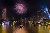BANGKOK-Jan 01:The happy new year 2011 exploding fireworks — Stock Photo