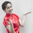 Asian Chinese woman in Traditional Chinese Cheongsam gesturing — Stock Photo #8631318