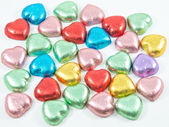 Colorful chocolate hearts candies,isolated — Stock Photo