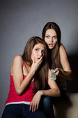 Two girls are watching TV — Stock Photo