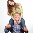 Stock Photo: Happy girl on mans shoulders