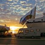 Ferry boat docks at sunset — Stock Photo