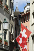 Zurich, swiss flags in the street. — Stock Photo