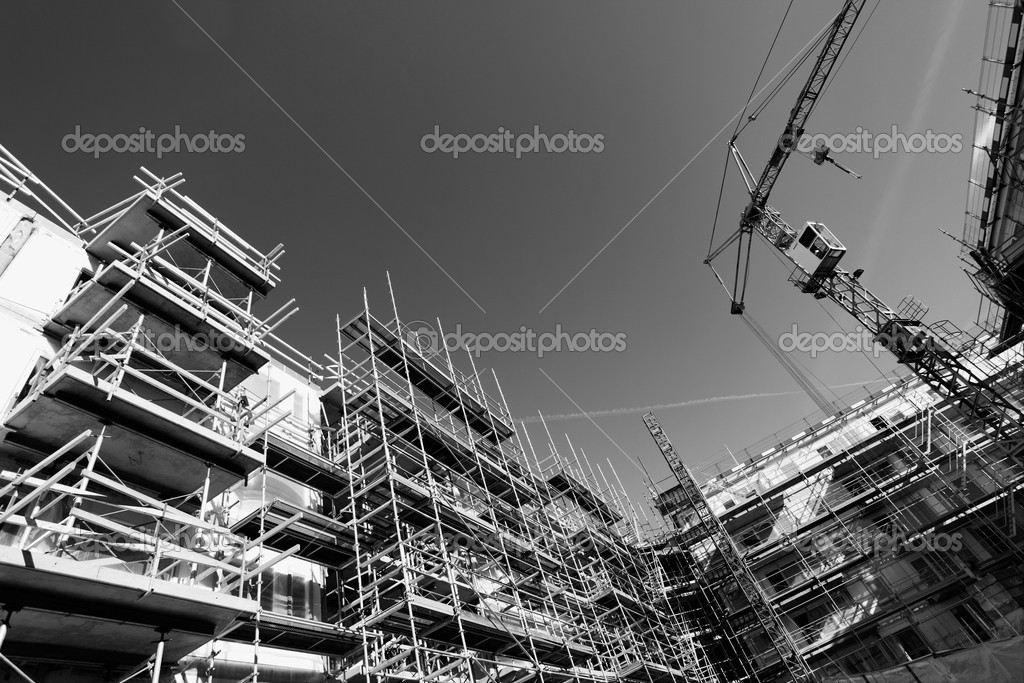 Construction site, cranes and scaffolding, blue toning concept  Stock Photo #10537238