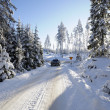 Car driving on snowy road — Stock Photo