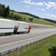 Trucking on long highway — Stock Photo