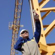 Building worker and mobile crane - Stock Photo