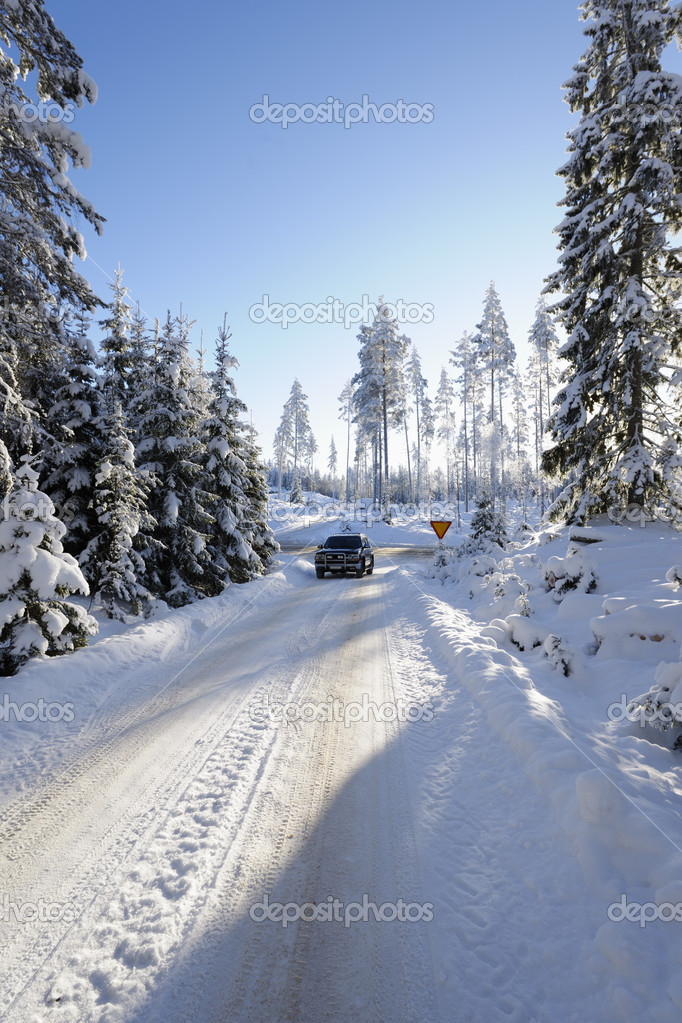 Car, suv, driving on small snowy road, winter landscape in sweden — Stock Photo #8014896