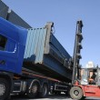 Truck and container forklift — Stock Photo