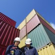 Container port and workers — Stock Photo