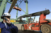 Worker and container port — Stock Photo