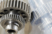 Titanium gears mirrored in steel — Stock Photo