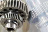 Titanium gears mirrored in steel — Stock Photo