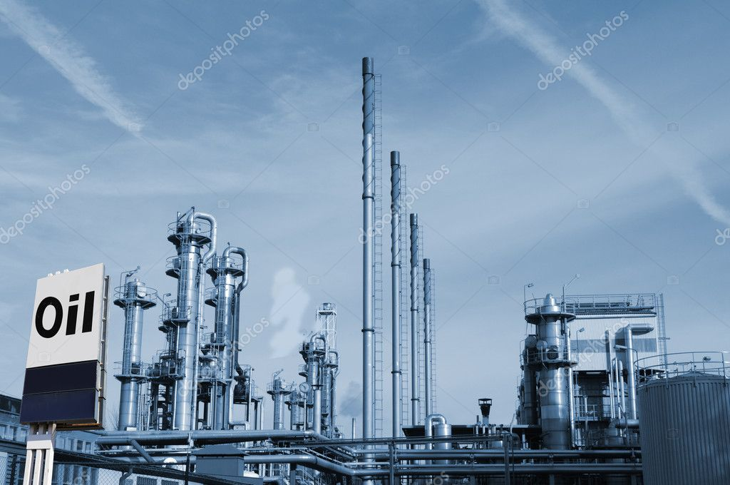 Oil and gas refinery, large commercial fuel information sign in foreground — Stock Photo #8308419