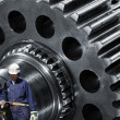 Metal workers with giant machinery — Stock Photo