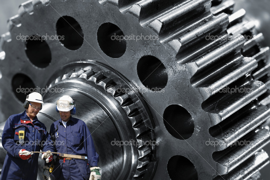 Two metal, steel-workers with large gear wheel machinery in background — ストック写真 #8374522