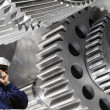 Metal worker with giant machinery — Stock Photo