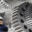 Stock Photo: Metal worker with giant machinery