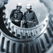 Engineers and gear machinery — Stock Photo