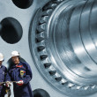 Industry workers and gears — Stock Photo