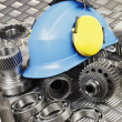 Hardhat and machine-parts concept — Stock Photo