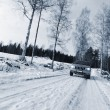 Car, suv, driving in snowy winter — Stockfoto