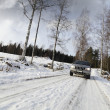 Car, suv, driving in snowy winter — Stock Photo