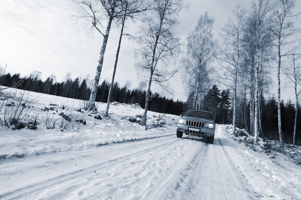 Large suv, car, driving on small country-road, winter, snow and ice, trees and forest.winter scenery from sweden. — Stock Photo #8841283