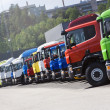 Truck convoy standing on line — Stock Photo
