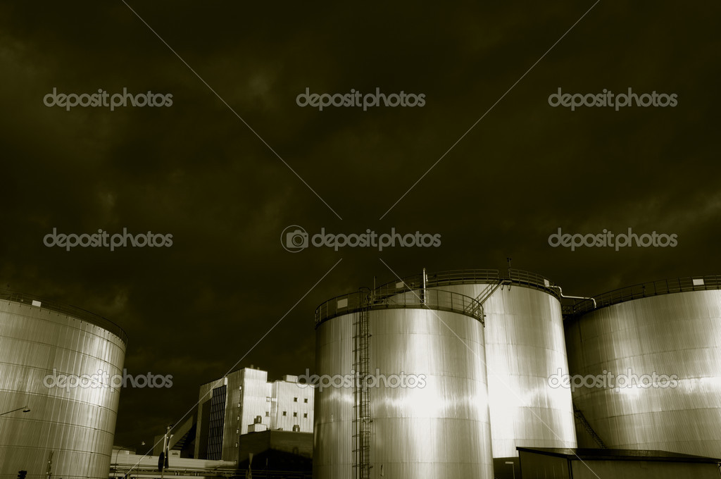 Fuel and oil storage towers, late evening sunlight, and duplex brown toning concept  Stock Photo #8886411