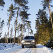 Suv, car, driving on snowy country road — Stok fotoğraf