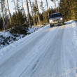 Suv, car, driving on snowy country road — Stock Photo #8940774