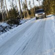 Stock Photo: Suv, car, driving on snowy country road