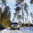 Suv, car, driving on snowy country road - Stock Photo