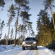 Suv, car, driving on snowy country road — Stockfoto