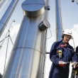 Gas workers and refinery — Stock Photo