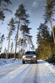 Suv, car, driving on snowy country road — Stock Photo