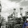 Oil workers inside chemical refinery — Stock Photo #8958384