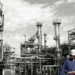 Oil workers inside chemical refinery — Stock Photo