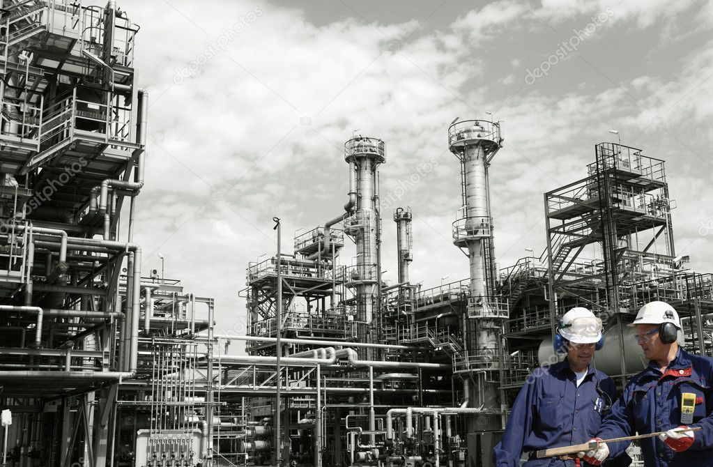 Two workers, engineers, inside large oil and gas installation — Stock Photo #8958384