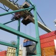 Stock Photo: Container crane stacking onto ship