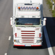 Truck driving head on against camera — Stock Photo