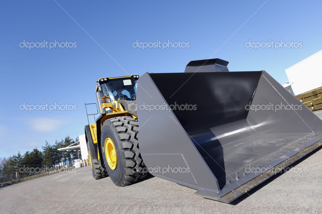 Large bulldozer, earthmover in action — Stock Photo #8961079