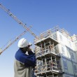 Contruction worker and building site — Stock Photo