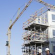 Contruction workers and building site — Stock Photo