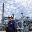Oil workers and chemical plant — Stock Photo