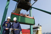 Container port, workers and shipping — Stock Photo